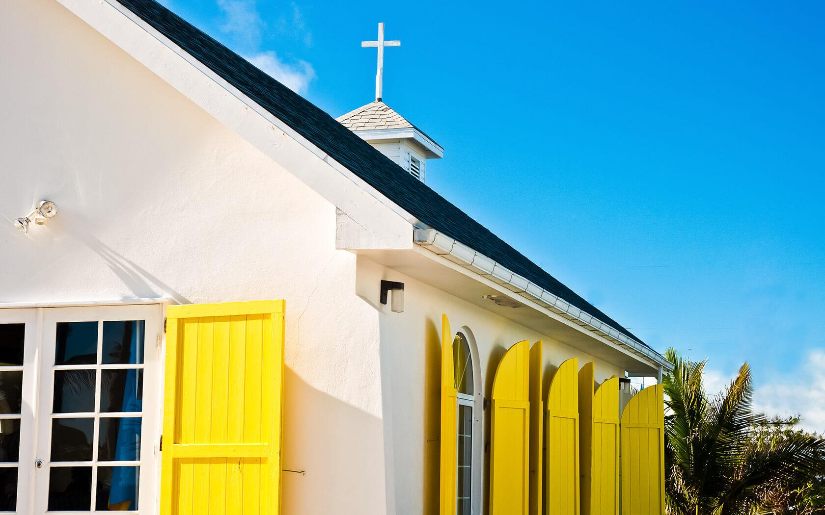 church with yellow shutters