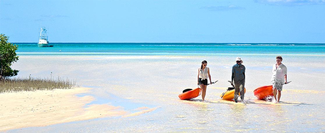Bahamian Ambassador sharing a kayaking spot with a visiting couple.